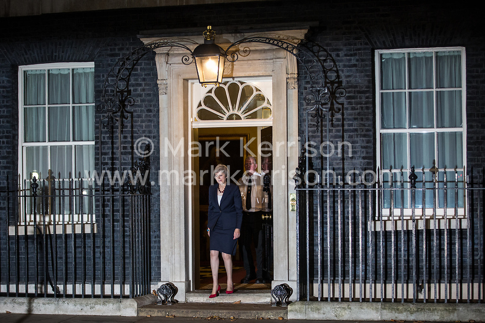 London, UK. 14th November, 2018. Prime Minister Theresa May prepares to make a statement to the media outside 10 Downing Street following approval of a draft Brexit agreement at a five-hour emergency Cabinet meeting.