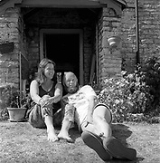 Michael and Jean Eavis relaxing in the back garden of Worthy Farm, Glastonbury, Somerset, 1989