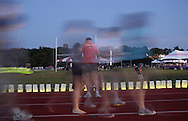 Goshen, New York - People walk laps around the track, which is lined with luminaria in remembrance of cancer victims, during the Relay for Life at Goshen High School on June 19, 2011. The Relay for Life is the American Cancer Society's signature fundraising event. Participants celebrate the lives of people who have battled cancer, remember loved ones lost, and fight back against the disease by raising money. The people walking are blurred because of their motion during the long exposure.