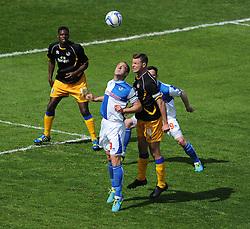 Bristol Rovers' Chris Beardsley battles for a high ball with Mansfield Town's John Dempster - Photo mandatory by-line: Alex James/JMP - Mobile: 07966 386802 03/05/2014 - SPORT - FOOTBALL - Bristol - Memorial Stadium - Bristol Rovers v Mansfield - Sky Bet League Two