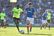 Portsmouth Midfielder, Ben Close (33) takes on Peterborough United Midfielder, Leo Da Silva Lopes (18) during the EFL Sky Bet League 1 match between Portsmouth and Peterborough United at Fratton Park, Portsmouth, England on 5 May 2018. Picture by Adam Rivers.