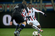 Onderwerp/Subject: Willem II - SC Heerenveen - Eredivisie<br /> Reklame:  <br /> Club/Team/Country: <br /> Seizoen/Season: 2012/2013<br /> FOTO/PHOTO: Virgil MISIDJAN (BEHIND) of Willem II in duel with Jeffrey GOUWELEEUW (FRONT) of SC Heerenveen. (Photo by PICS UNITED)<br /> <br /> Trefwoorden/Keywords: <br /> #04 #22 $94 ±1342781806743<br /> Photo- & Copyrights © PICS UNITED <br /> P.O. Box 7164 - 5605 BE  EINDHOVEN (THE NETHERLANDS) <br /> Phone +31 (0)40 296 28 00 <br /> Fax +31 (0) 40 248 47 43 <br /> http://www.pics-united.com <br /> e-mail : sales@pics-united.com (If you would like to raise any issues regarding any aspects of products / service of PICS UNITED) or <br /> e-mail : sales@pics-united.com   <br /> <br /> ATTENTIE: <br /> Publicatie ook bij aanbieding door derden is slechts toegestaan na verkregen toestemming van Pics United. <br /> VOLLEDIGE NAAMSVERMELDING IS VERPLICHT! (© PICS UNITED/Naam Fotograaf, zie veld 4 van de bestandsinfo 'credits') <br /> ATTENTION:  <br /> © Pics United. Reproduction/publication of this photo by any parties is only permitted after authorisation is sought and obtained from  PICS UNITED- THE NETHERLANDS