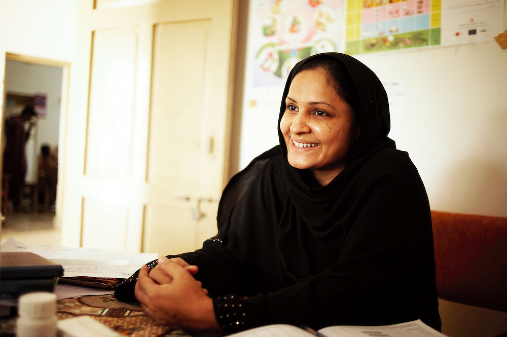 Rabiya Yasmin, 32 years old, a health promoter at the Bhu Khero government health clinic, Dadu,  Sindh, Pakistan on July 5, 2011. She sees up to 40 women and children a day. It's her first job and she feels empowered since she started 2 months ago.