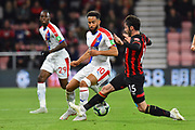 Adam Smith (15) of AFC Bournemouth makes a tackle on Andros Townsend (10) of Crystal Palace during the Premier League match between Bournemouth and Crystal Palace at the Vitality Stadium, Bournemouth, England on 1 October 2018.