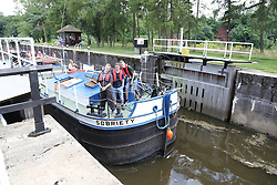 Barge going through a canal lock