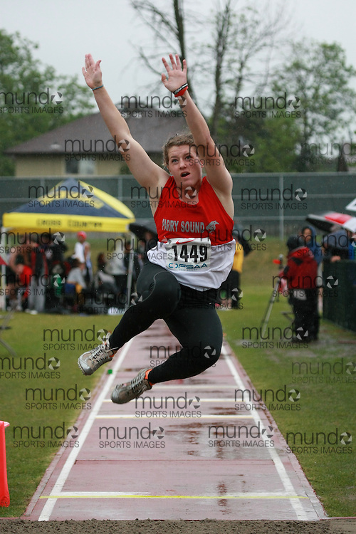 Allie Weeks of Parry Sound HS - Parry Sound competes in the senior girls long jump at the 2013 OFSAA Track and Field Championship in Oshawa Ontario, Thursday,  June 6, 2013.<br /> Mundo Sport Images / Sean Burges