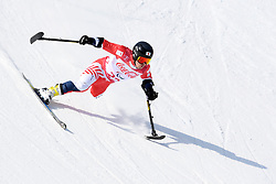 MISAWA Hiraku LW2 JPN competing in the Para Alpine Skiing Downhill at the PyeongChang2018 Winter Paralympic Games, South Korea