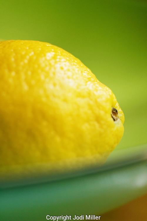A lemon in a bowl.