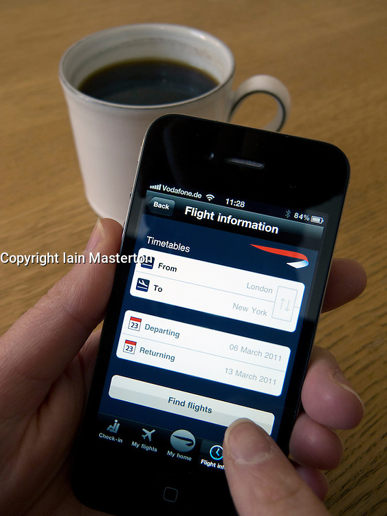 Checking passenger flight information on British Airways application on an Apple iphone 4G smart phone