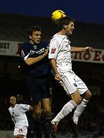 Photo: Chris Ratcliffe.<br />Southend United v Brentford. Coca Cola League 1. 14/01/2006.<br />Michael Turner (R) of Brentford goes up for a header with Mark Bentley of Southend.