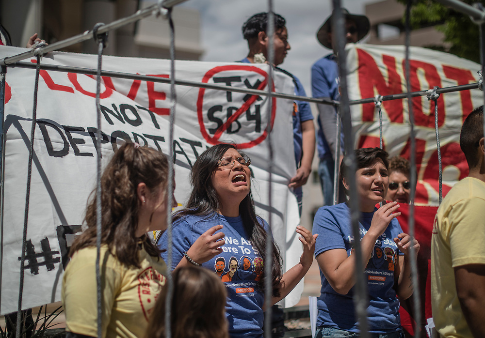 rer05017c/metro/May 01, 2017/Albuquerque Journal<br /> Albuquerque's immigrant community protest recent wave of deportation outside of metro court in downtown.  Pictured is Yazmin Irazoqui Ruiz(Cq), second from the left, shouts in protest  inside a makeshift prison on 4th street.   <br /> Roberto E. Rosales/Albuquerque Journal