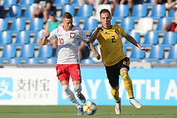 June 16, 2019 - Reggio, Italy - Poland's Sebastian Szymanski and Belgium's Dion Cools fight for the ball during a game between the U21 youth team of the Belgian national soccer team Red Devils and Poland, Sunday 16 June 2019, match 1/3 in group A at the 2019 European championships under 21 in Reggio, Italy. (Credit Image: © Bruno Fahy/Belga via ZUMA Press)