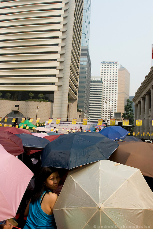 Thousands of Philipino house-maids are having picknic in the city every Sunday, their day off.