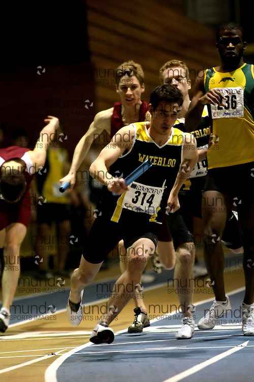 Windsor, Ontario ---14/03/09--- Chris Lam of  the University of Waterloo competes in the Men's 4x400m Relay at the CIS track and field championships in Windsor, Ontario, March 14, 2009..Sean Burges Mundo Sport Images