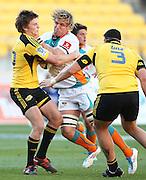 Cheetahs' Justin Downey runs into the tackle of Hurricanes' Beauden Barrett during the 2012 Super Rugby season, Hurricanes v Cheetahs at Westpac Stadium, Wellington, New Zealand on Saturday 31 March 2012. Photo: Justin Arthur / Photosport.co.nz