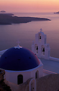 GREECE.The Cyclades: Santorini (Thira) . Lava flows visible off the coast of Thira, seen from a.Church in Firostefani