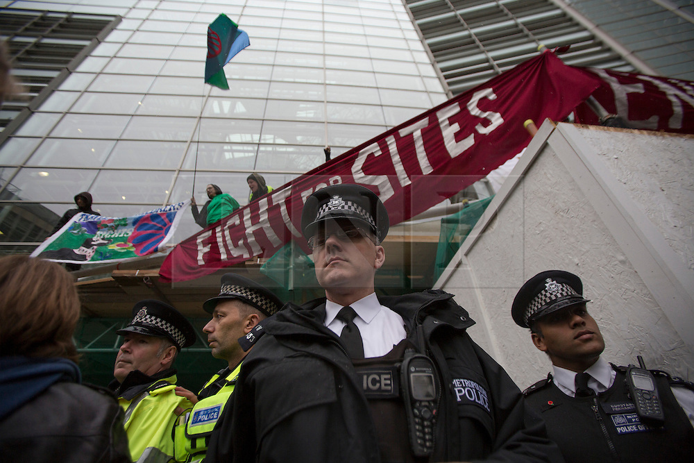 © licensed to London News Pictures. London, UK 19/10/2012. Police officer outside Department for Communities and Local Governments in London during a protest to mark the first anniversary of the Dale Farm eviction. Photo credit: Tolga Akmen/LNP