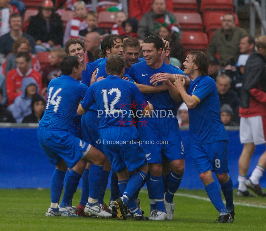 Wrexham, Wales - Saturday, May 26, 2007: New Zealand's Shane Smeltz celebrates his second goal with team-mates against Wales during the International Friendly match at the Racecourse Ground. (Pic by David Rawcliffe/Propaganda)