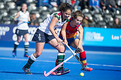 Surbiton's Julia King is tackled by Anna Toman of University of Birmingham. University of Birmingham v Surbiton - Semi-Final - Investec Women's Hockey League Finals, Lee Valley Hockey & Tennis Centre, London, UK on 22 April 2017. Photo: Simon Parker