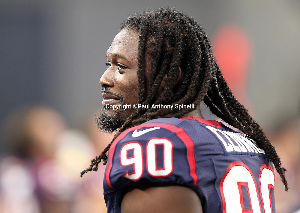 Houston Texans outside linebacker Jadeveon Clowney (90) has a laugh on the sideline during the 2015 NFL preseason football game against the Dallas Cowboys on Thursday, Sept. 3, 2015 in Arlington, Texas. The Cowboys won the game 21-14. (©Paul Anthony Spinelli)
