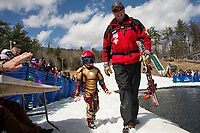 Jaxon Bartlett gets a hand from Ski Patrol Marty Barrett after his attempt to cross the pond during Gunstock's annual end of season B.Y.O.D.C. event Sunday afternoon.  (Karen Bobotas/for the Laconia Daily Sun)