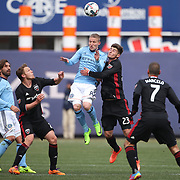 NEW YORK, NEW YORK - March 12:  Alexander Ring #8 of New York City FC is challenged by Ian Harkes #23 of D.C. United during the NYCFC Vs D.C. United regular season MLS game at Yankee Stadium on March 12, 2017 in New York City. (Photo by Tim Clayton/Corbis via Getty Images)