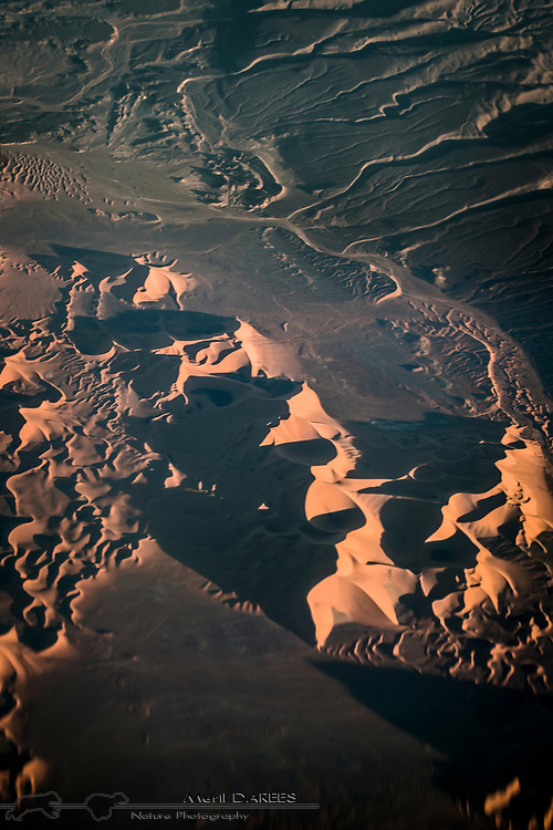 Sahara dunes at sunset from an airliner. Algeria.