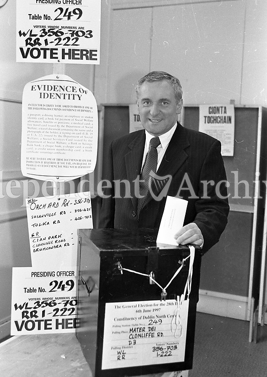 Fianna Fail Leader Bertie Ahern casting his vote at the Mater Dei, Clonliffe Road, 06/06/1996 (Part of the Independent Newspapers Ireland/NLI Collection).