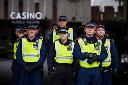 © Licensed to London News Pictures. 04/11/2015. London, UK. Police guard a casino as Thousands of students take part in a demonstration in central London against tuition fees. The rally which starts outside the University of London Union, will feature a speech from Shadow Chancellor John McDonnell.  Photo credit: Ben Cawthra/LNP
