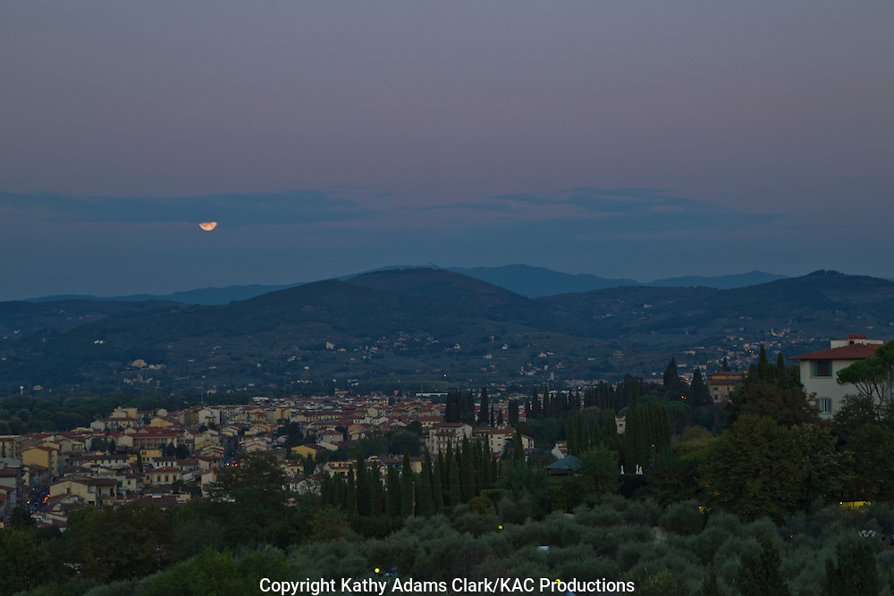 Moon rise over Florence, Firenze, Italy.