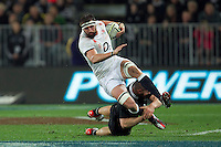 Tom Wood of England is tackled during the Steinlager Series match at Forsyth Barr Stadium, Dunedin<br /> Picture by Teaukura Moetaua/Focus Images Ltd +64 27 7251 349<br /> 14/06/2014