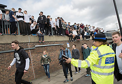 © Licensed to London News Pictures. 04/03/2017. Guildford, UK. A PCSO looks on as free runners hold a memorial to remember Nye Newman who died in January. Nye Newman, whose death is thought not to be related to Parkour, died in Paris. Free running or Parkour involves jumping and climbing on building, railings and walls.  Photo credit: Peter Macdiarmid/LNP