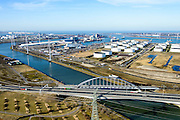 Nederland, Zuid-Holland, Rotterdam, 18-02-2015. Europoort, Dintelhavenbruggen voor spoor (Betuweroute) en A15. Dintelhavenbrug over Hartelkanaal, gezien naar Dintelhaven en Beneluxhaven.<br /> Motorway A15 and freight railway bridges crossing Hartelkanaal, Dintel harbour and Benelux harbor.<br /> luchtfoto (toeslag op standard tarieven);<br /> aerial photo (additional fee required);<br /> copyright foto/photo Siebe Swart