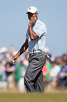 Golf - 2013 Open Championship at Muirfield - Friday Round Two<br /> Tiger Woods of USA smiles following the 6th