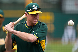 OAKLAND, CA - JUNE 14:  Bob Melvin #6 of the Oakland Athletics hits a baseball during batting practice before the game against the New York Yankees at O.co Coliseum on June 14, 2014 in Oakland, California. The Oakland Athletics defeated the New York Yankees 5-1.  (Photo by Jason O. Watson/Getty Images) *** Local Caption *** Bob Melvin