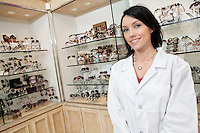 Portrait of a happy optometrist in store