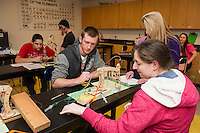 Justin Bilodeau and Dianna Walton work with Mrs. Borski to apply the calculations for their robotic arm in JoAnne Gilbert's Applied Science class at LHS Monday afternoon.  (Karen Bobotas/for the Laconia Daily Sun)