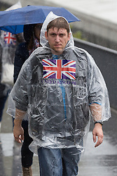 © Licensed to London News Pictures. 17/11/2015. London, UK. A tourist in a rain poncho near the Tower of London during wet and windy weather today. Photo credit : Vickie Flores/LNP