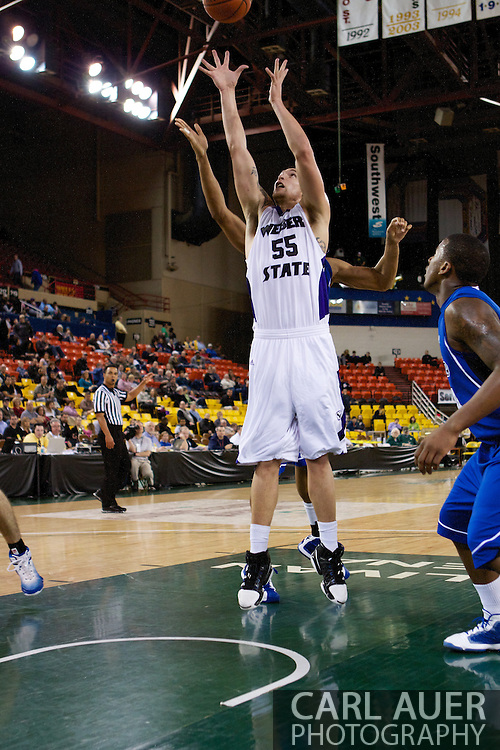 November 27th, 2010:  Anchorage, Alaska - Weber State senior center Trevor Morris (55) reaches up for a rebound in the Wildcat's 82-81 win over the Drake Bulldogs in the third place game of the Great Alaska Shootout.