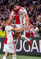 14-08-2018 NED: Champions League AFC Ajax - Standard de Liege, Amsterdam<br /> Third Qualifying Round,  3-0 victory Ajax during the UEFA Champions League match between Ajax v Standard Luik at the Johan Cruijff Arena / Klaas Jan Huntelaar #9 of Ajax celebrates his first goal 1-0 with nicolas Tagliafico #31 of Ajax