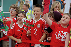 CARDIFF, WALES - Saturday, June 4, 2016: School children at Cardiff Airport as they cheer the Wales team prior to their departure to Sweden ahead of the European Championships 2016 in France. (Pic by David Rawcliffe/Propaganda)