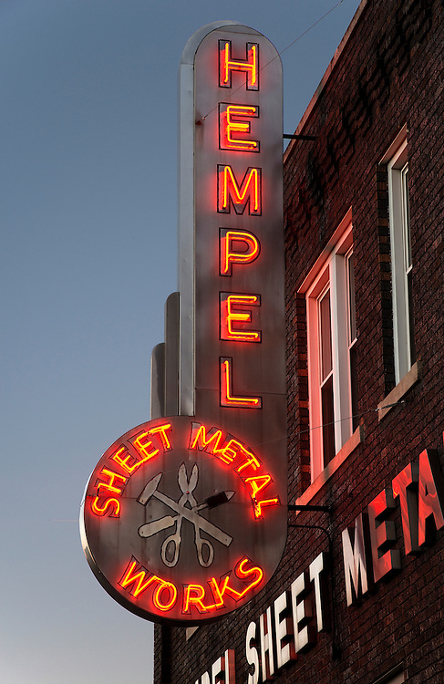 The sign for Hempel Sheet Metal Works in Omaha invokes several Art Deco elements, including streamlined curves, ornamental metalwork, and, of course, neon.
