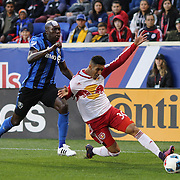 HARRISON, NEW JERSEY- November 06:  Gonzalo Veron #30 of New York Red Bulls is challenged by Hassoun Camara #6 of Montreal Impact during the New York Red Bulls Vs Montreal Impact MLS playoff match at Red Bull Arena, Harrison, New Jersey on November 06, 2016 in Harrison, New Jersey. (Photo by Tim Clayton/Corbis via Getty Images)