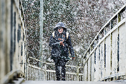 © London News Pictures. 04/03/2016 Aberystwyth, Wales, UK.  Winter returns with early morning snowfall in Aberystwyth as people make their way to work, school and university. Photo credit: Keith Morris/LNP