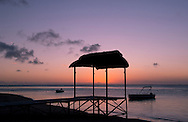 A pier at sunset on the beach of the St Regis hotel on Le Morne Brabant Peninisula, south west coast of Mauritius, the Indian Ocean