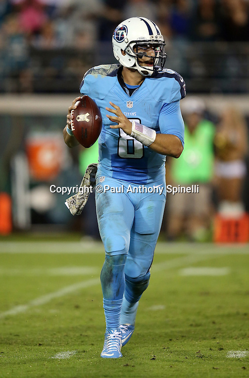 Tennessee Titans quarterback Marcus Mariota (8) rolls out while looking to pass during the 2015 week 11 regular season NFL football game against the Jacksonville Jaguars on Thursday, Nov. 19, 2015 in Jacksonville, Fla. The Jaguars won the game 19-13. (©Paul Anthony Spinelli)