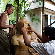 May 14, 2013 - Mandalay, Myanmar: A local worker makes the mould for a buddha copper statue at a traditional workshop in Mandalay. CREDIT: Paulo Nunes dos Santos