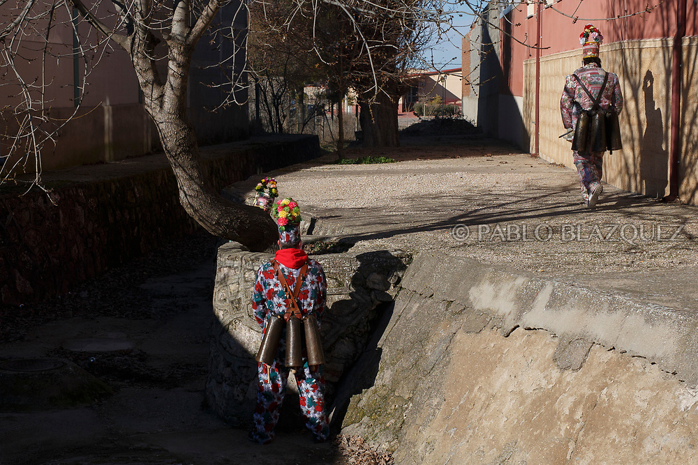 2018/02/02. ALMONACID DEL MARQUESADO, SPAIN - JANUARY 16: Worshippers dressed as Diablos 'Devils' take a break during the Endiablada 'The Brotherhood of the Devils' festival on February 2, 2018 in Almonacid del Marquesado, Cuenca province, Spain. La Endiablada is a centenary tradition of unknown origins celebrated on Virgen de la Candelaria 'Our Lady of Candelaria' and San Blas 'Saint Blaise' days. The Diablos wear colourful clothes, a hat and carry bells and personalised porras 'batons'. (Photo by Pablo Blazquez Dominguez)