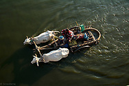 Two farmers on ox cart are crossing the Taungthaman Lake near Amarapura in Myanmar.<br />