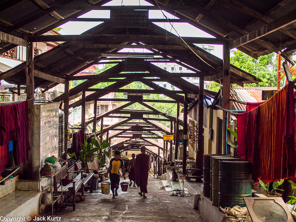 05 JUNE 2014 - YANGON, YANGON REGION, MYANMAR:  A covered walkway at Chauktatgyi Paya (Pagoda) in Yangon, Myanmar. Yangon, with a population of over five million, continues to be the country's largest city and the most important commercial center.    PHOTO BY JACK KURTZ